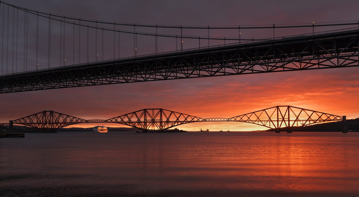 Stunning sunrise over the Forth Rail Bridge, Edinburgh, Scotland