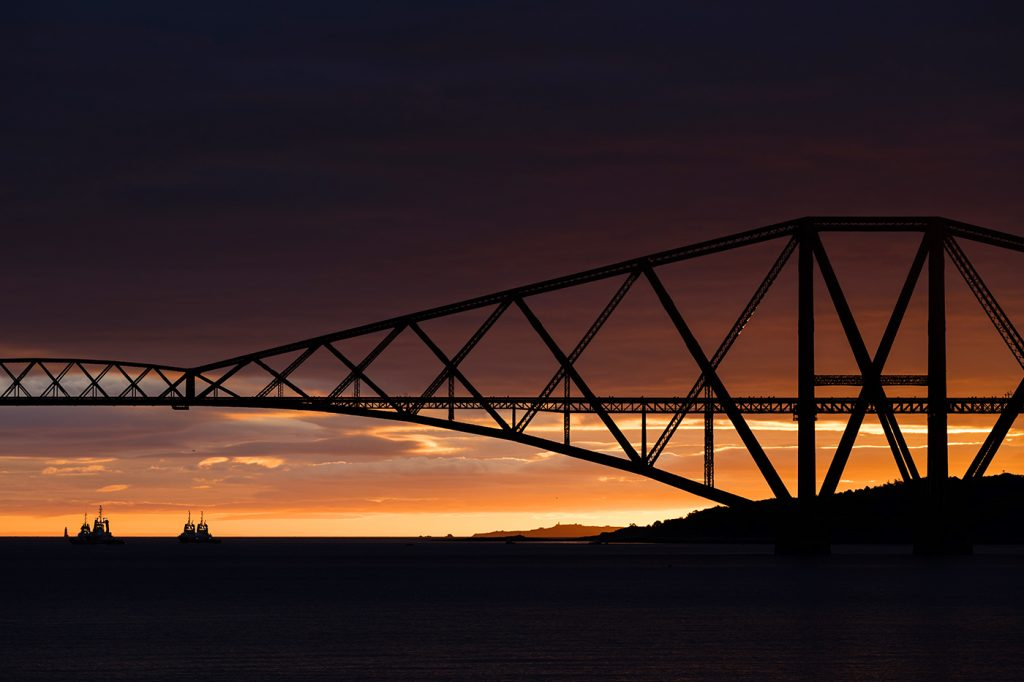Close up shot of the Forth Rail Bridge at sunrise, Edinburgh