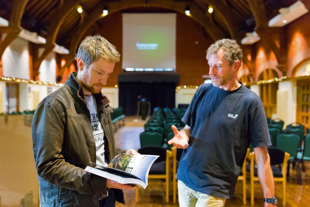 Thomas Heaton with FotoVUE's Stuart Holmes and their latest superb Peak District photo location guide book
