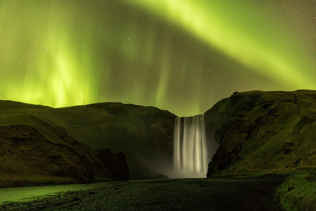 kp5 Aurora Borealis over the 200ft Skogafoss Waterfall, Iceland