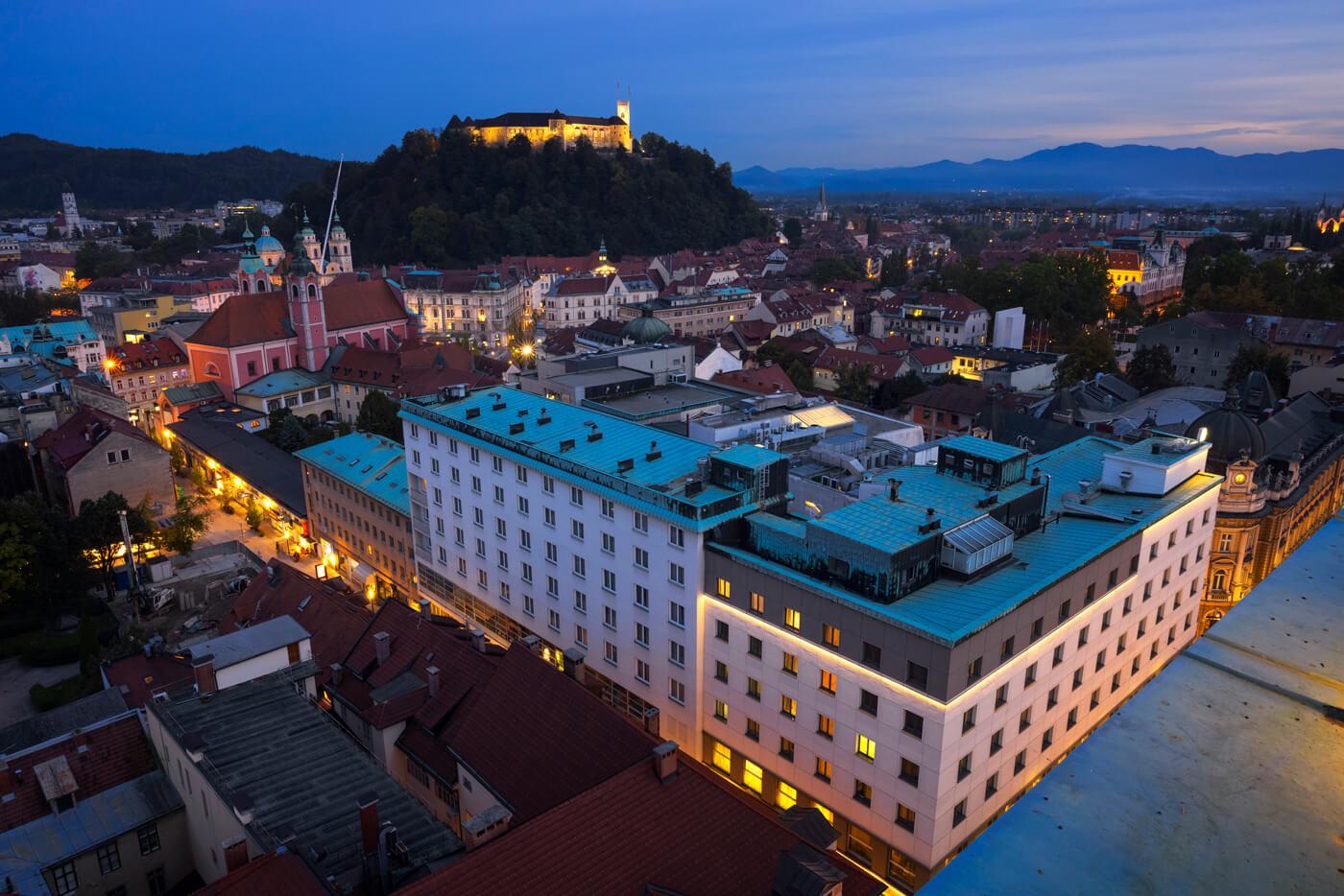 Ljubljana city centre and castle at dusk