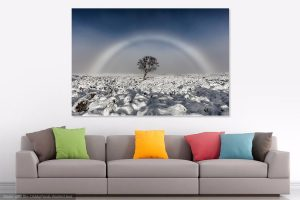 Print of Fogbow hanging on the wall above a sofa